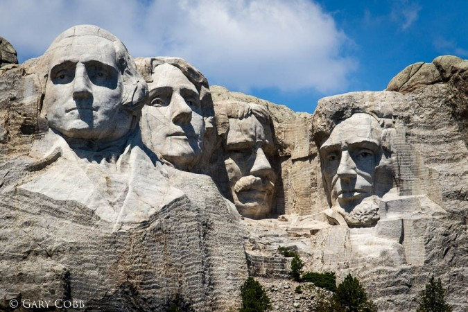 Create a Mount Rushmore with significant women instead of male presidents. Give a rationale for each woman you chose.