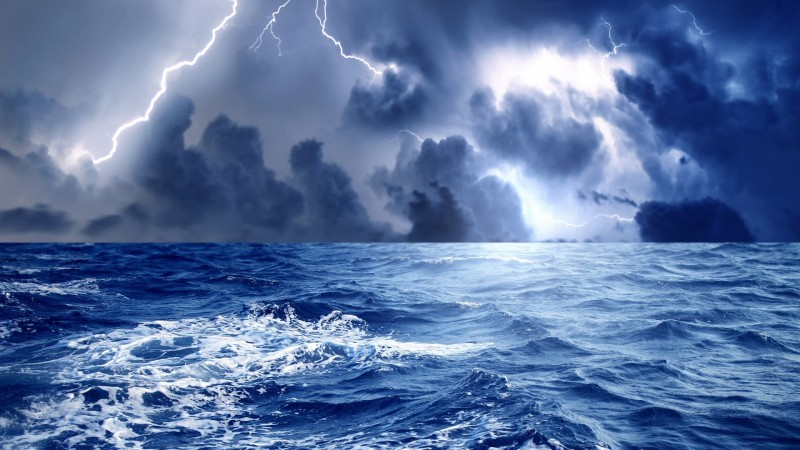 From the perspective of a fish, write a story about a storm taking place on the sea.