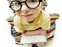 little-boy-with-glasses-surrounded-by-books_1098-2099