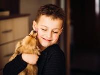pretty-child-hugs-little-dog_1304-3217