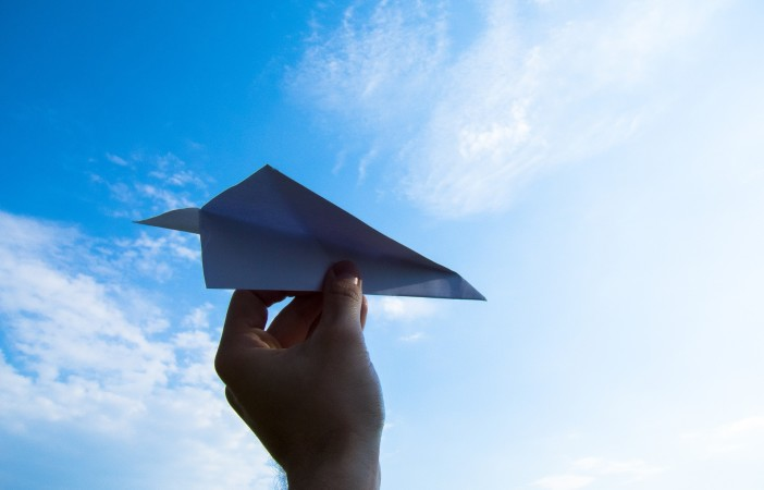 Create a tutorial on how to make a paper airplane.