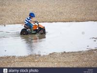 quading through a big puddle